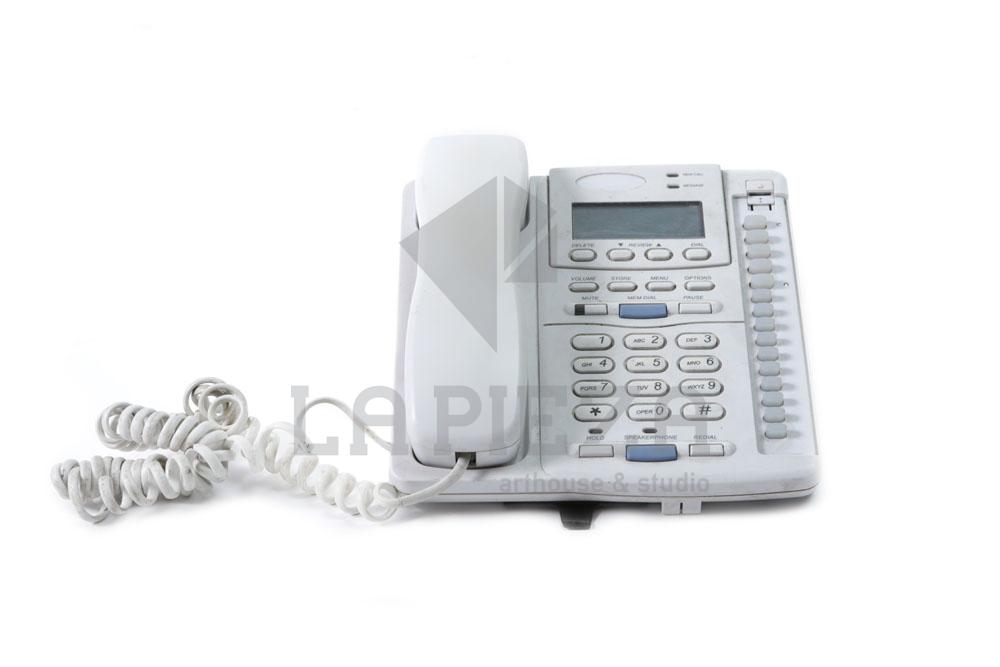 Tel fono de oficina la pieza for La oficina telefono
